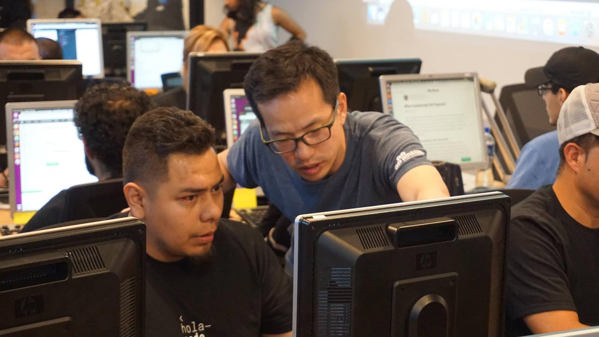 Hola Code teacher and student working