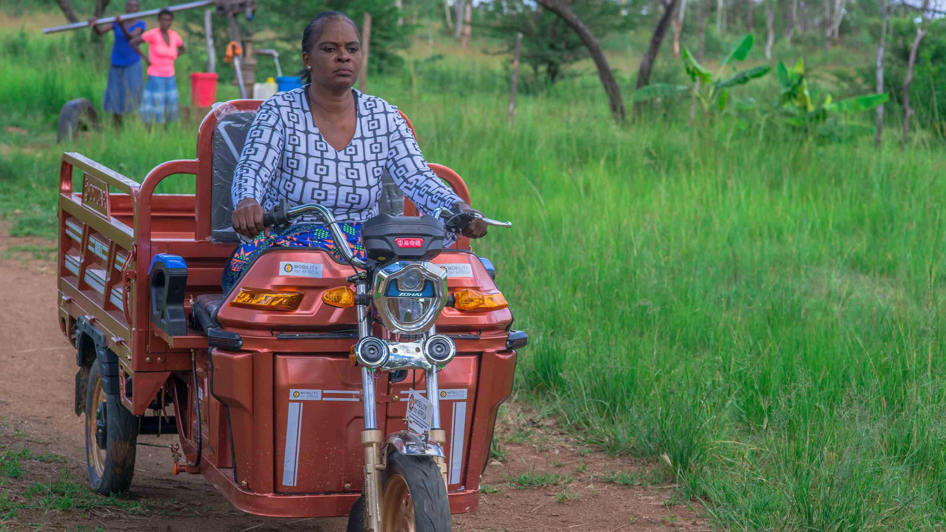 Zimbabwean woman driving tricycle