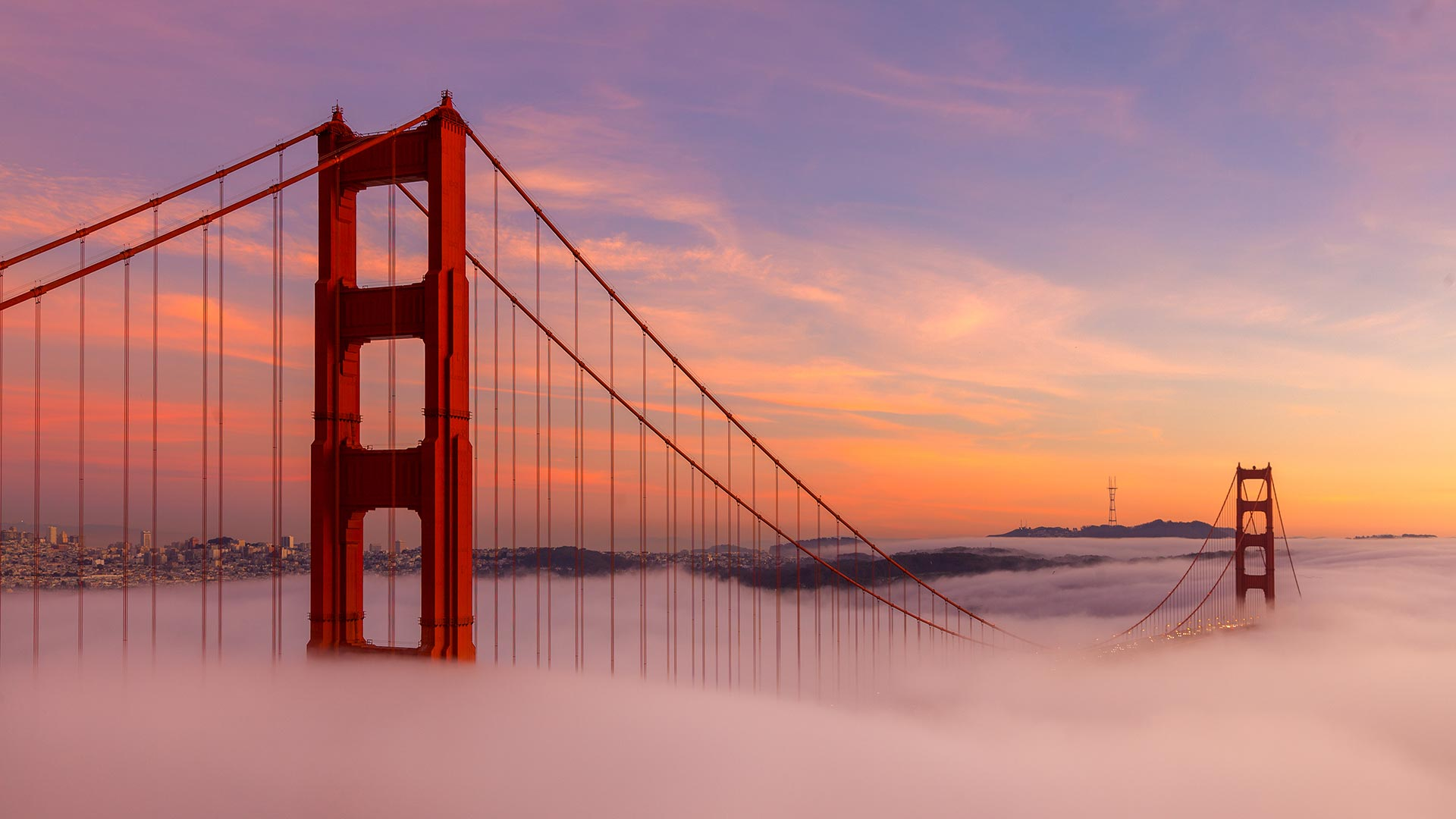 Golden Gate Bridge at sunrise with fog