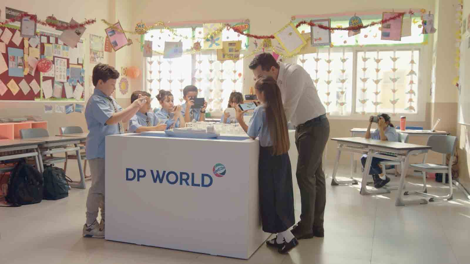 Children at DP World kiosk