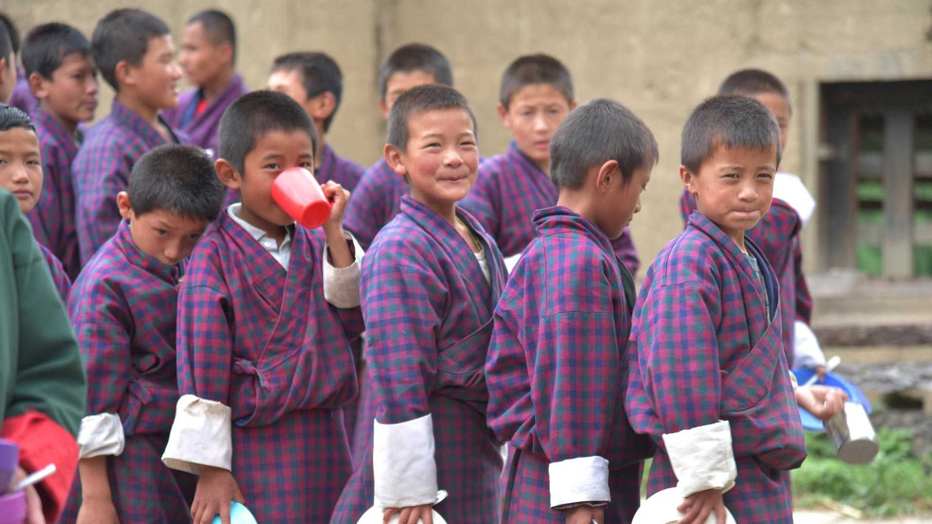 Pupils from Bhutan queuing for meal