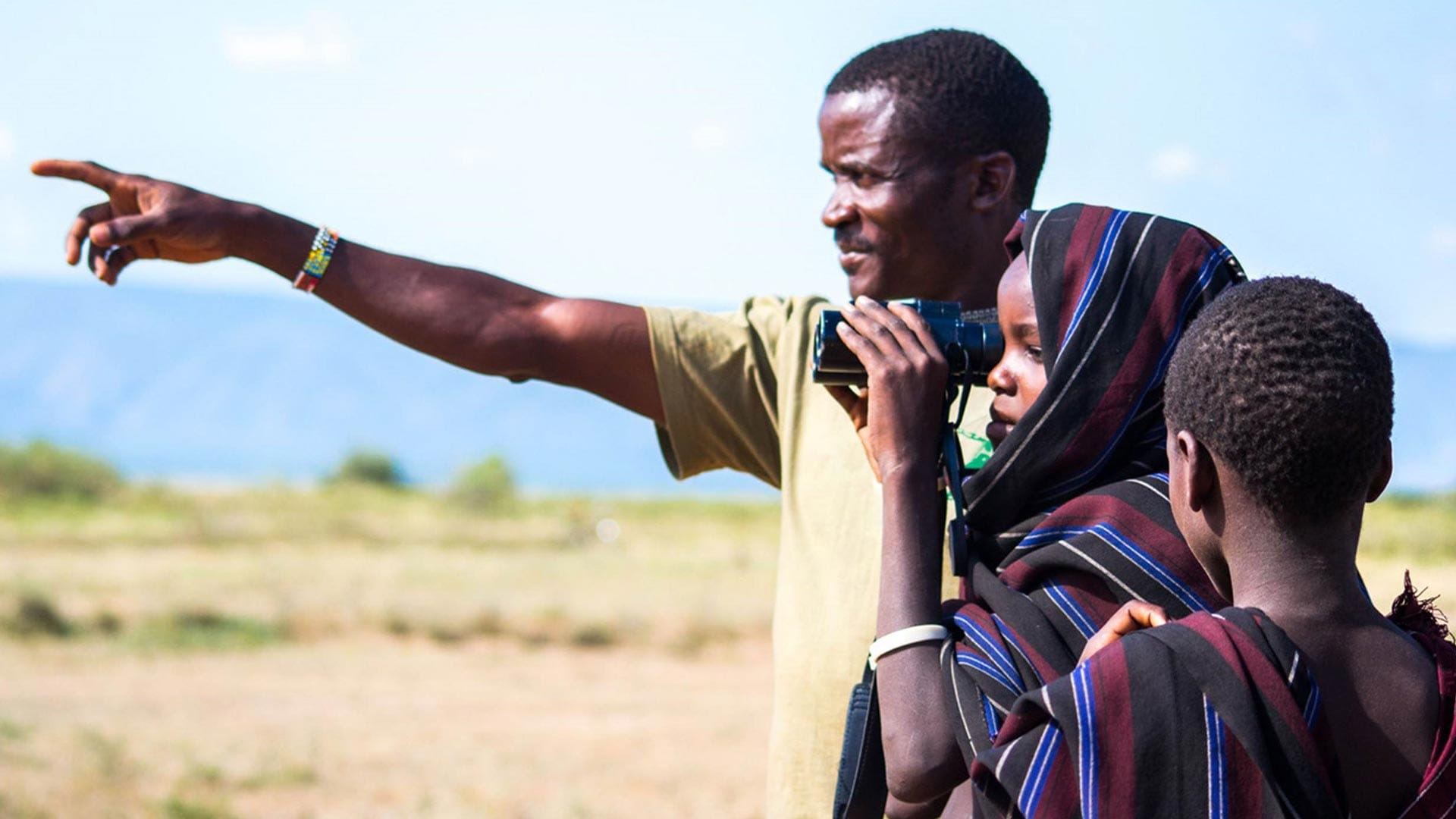 Locals from Tanzania looking through binoculars in the Mbulu District