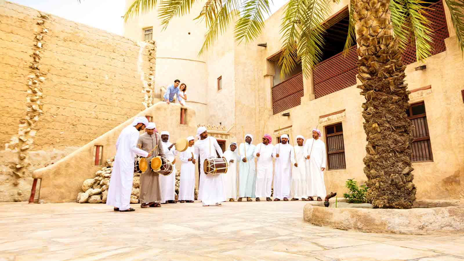Emirati men dancing in Ajman Museum